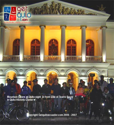 Mountain bikers at Teatro Sucre in a night trip aroun Quito HIstoric Center